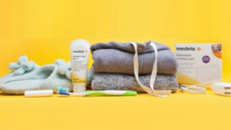 Medela products placed alongside bedtime apparel (pajamas, slippers, toothbrush)
