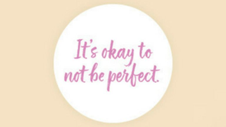 "White circle with words ""It's okay to not be perfect"" written inside"