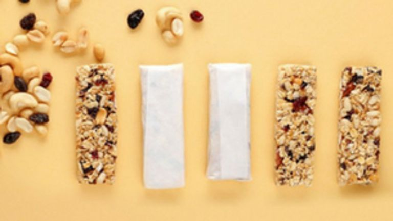 Five granola bars: three unwrapped and two wrapped