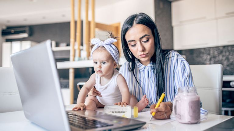 mom at laptop taking notes with baby