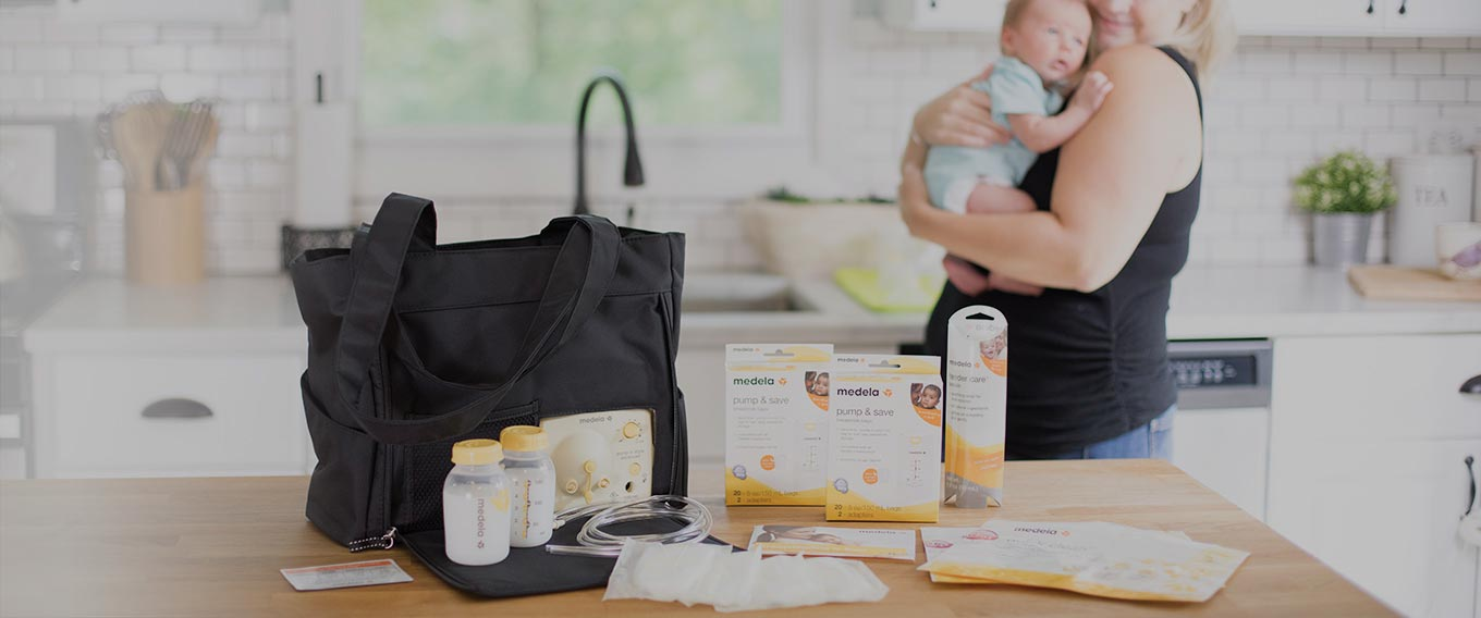 A mom using a Medela breastfeeding pump